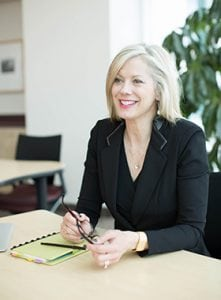 Career Coach Kim Monaghan sitting at a desk