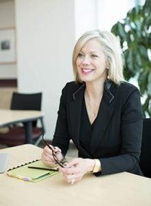 Career Coach Kim Monaghan sitting at a desk